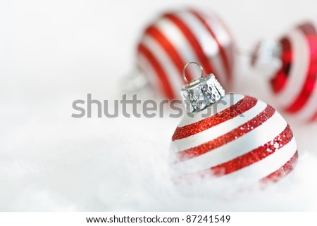 Christmas Holiday ornaments on snow background - stock photo