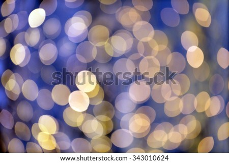 christmas, holidays and background concept - blurred blue and golden lights bokeh - stock photo