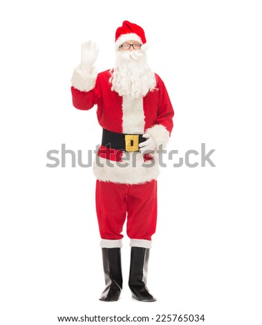christmas, holidays, gesture and people concept - man in costume of santa claus waving hand - stock photo