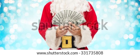 christmas, holidays, winning, currency and people concept - close up of santa claus hands holding dollar money over blue lights background - stock photo