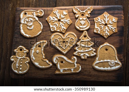 Christmas homemade cookies on wooden board from overhead