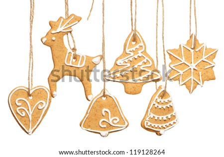 Christmas homemade gingerbread cookies over white - stock photo