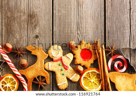 Christmas homemade gingerbread cookies over wooden table - stock photo