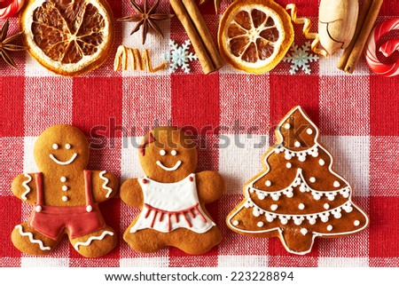 Christmas homemade gingerbread couple and tree on tablecloth