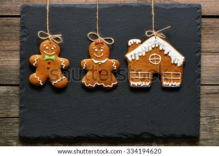 Christmas homemade gingerbread couple cookies over slate - stock photo