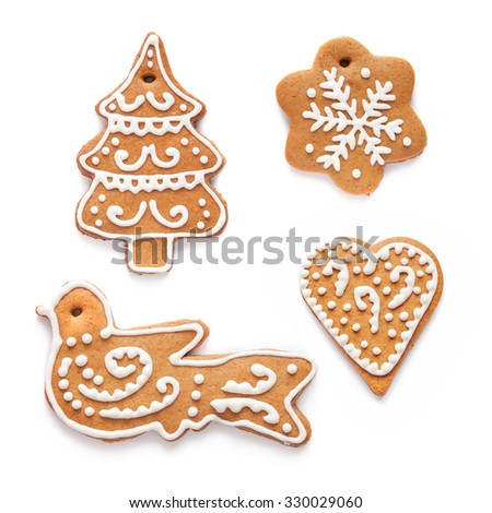 Christmas homemade gingerbread couples on the white background - stock photo