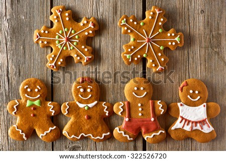 Christmas homemade gingerbread couples on wooden table - stock photo