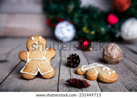 Christmas homemade gingerbread man on wooden background