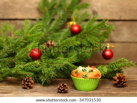 Christmas Homemade Muffins with candied fruit - stock photo