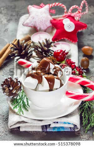 Christmas hot chocolate with festive decorations, candy