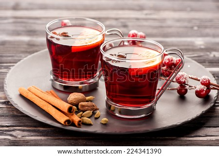 Christmas hot drink mulled wine with spices - stock photo
