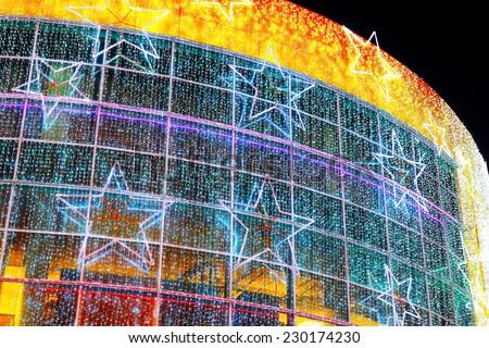 Christmas illumination on facade of modern building, as background - stock photo