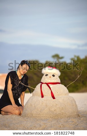 Christmas in Florida - girl and sandman on the beach
