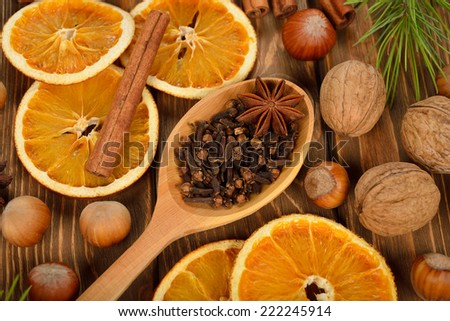 Christmas ingredients on a brown background - stock photo
