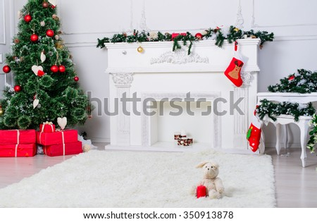 Christmas Interior decoration with Christmas socks, fireplace and tree. shallow DOF, color toned image - stock photo