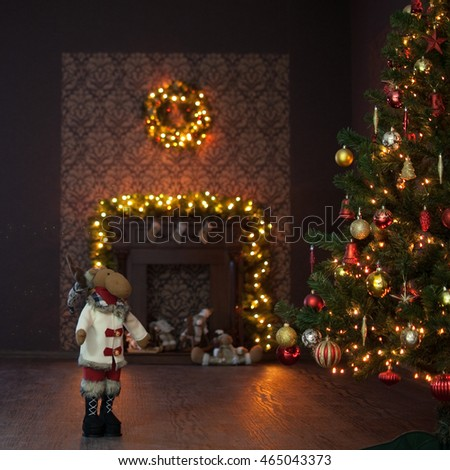 Christmas interior with garland, tree and deer