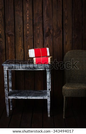 Christmas interior, wooden background with furniture and gifts