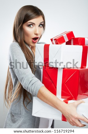 Christmas isolated woman portrait hold christmas gift. Smiling happy girl on white background. - stock photo