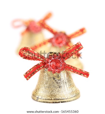 Christmas jingle bells with red ribbon. Blurred background. - stock photo