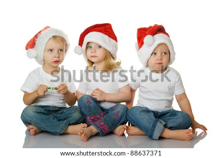 Christmas kids in Santa hat isolated on white background - stock photo