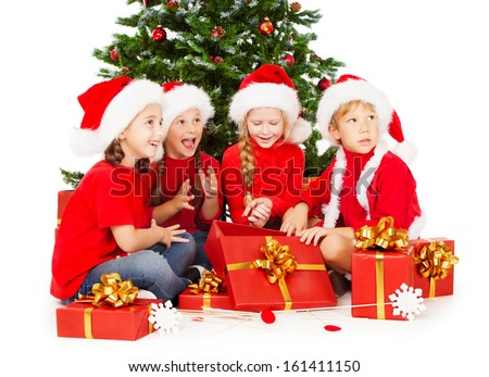 Christmas kids in Santa hat  with presents sitting under fir tree. White background.