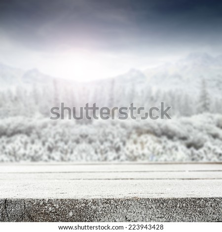 christmas landscape of mountains and free space on desk with snow and frost  - stock photo