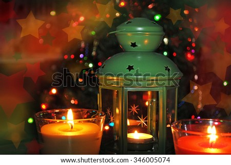 Christmas Lantern and burning candles in the dark