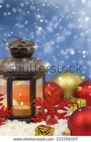 Christmas lantern and ornaments on snow