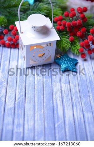 Christmas lantern, fir tree and decorations  on light background - stock photo