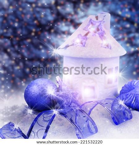 Christmas lantern with Christmas decoration on the snow. - stock photo