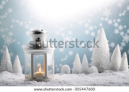 Christmas lantern with snowfall,Closeup. - stock photo