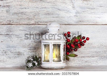 Christmas lantern with tree and snow on vintage wooden background - stock photo