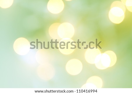 Christmas light bokeh in shades of green and yellow - stock photo