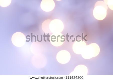 Christmas light bokeh in shades of purple - stock photo