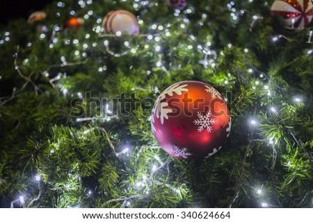 Christmas light on Christmas ornaments tree - stock photo
