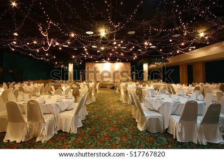 christmas lighting or wedding chinese style with dining table in the hall for celebration on light shining in the hotel