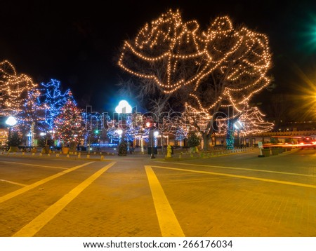 Christmas lights and decorations on historic Santa Plaza in New Mexico - stock photo