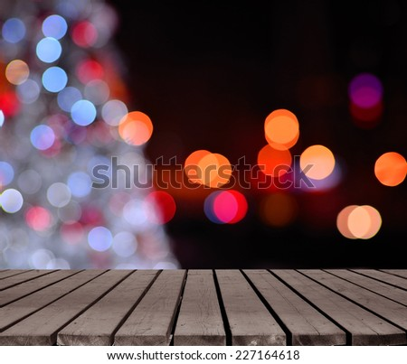Christmas lights bokeh defocused abstract background and empty wooden platform - stock photo