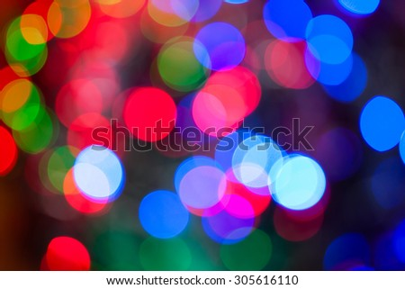 Christmas lights color bokeh - A bright multicolor bokeh background created by a set of de-focused Christmas lights. - stock photo