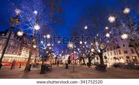 Christmas Lights Display on Sloane Square in Chelsea, London. The modern colorful Christmas lights attract and encourage people to the street.