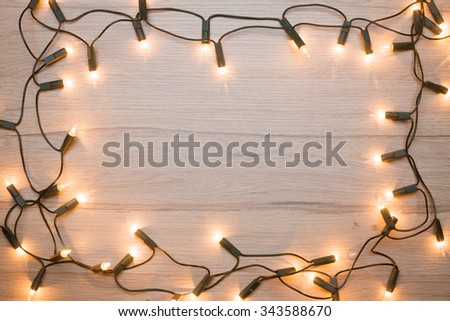 Christmas lights  frame on a wood