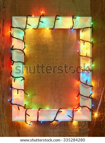 Christmas lights frame with copy space. Decorative garland - stock photo