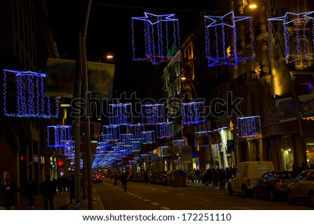 Christmas lights in Barcelona street at night - stock photo