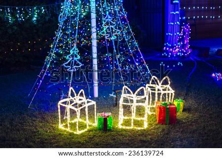 Christmas lights in garden. - stock photo