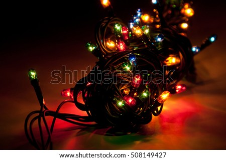 Christmas lights on dark background. Shallow depth of field