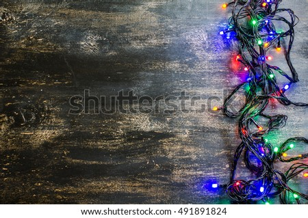 Christmas lights on dark rustic background