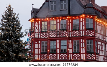 Christmas lights on half-timbered Old Town Hall and Christmas tree in Lorsch, Hesse, Germany