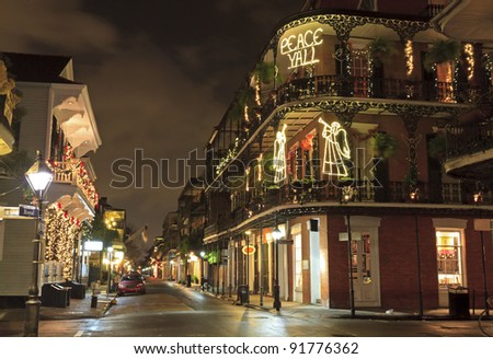 Christmas Lights on the corner of Royal and Dumaine Streets spell out a very Southern greeting in the French Quarter of New Orleans - stock photo