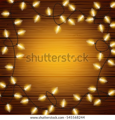 Christmas lights on wood texture background with copyspace