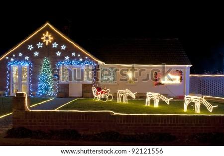 lighting a house. christmas lights outside on a house lighting